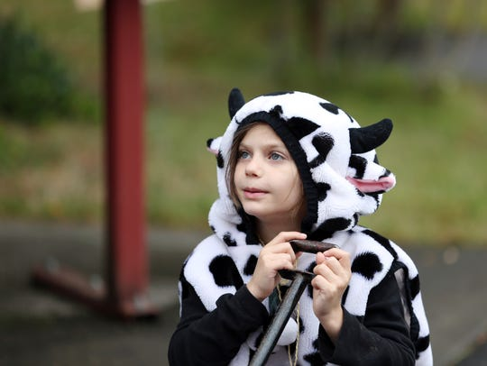 Ivy Miller, 7, dresses as a cow during the fifth annual