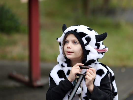 Ivy Miller, 7, dresses as a cow during the fifth annual Oregon Trail Live, an immersive, live-action re-creation of the classic video game of the same name, on Saturday, Sept. 17, 2016, at the Willamette Heritage Center in Salem.