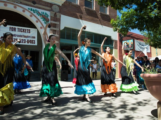 Alma de Arte Charter High School Flamenco Dancers perform Saturday, September 17, 2016, during the Plaza de Las Cruces dedication parade at downtown Main Street.