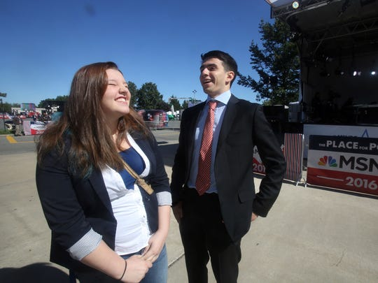 Jesse Saunders, left, president of the Hofstra University Democrats, and Nathanial Aron, president of the university's College Republicans, share a laugh on campus Saturday, a day before the first presidential debate takes place at the university in Hempstead, Long Island. The two students have appeared together on various media outlets to share their opposing political views.