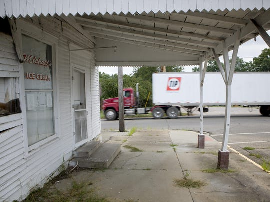 A semi-trailer passes the original Michael's Ice Cream, now vacant, along Ohio 93. The state route was once a major artery that took travelers through the town of Jackson before the four-lane Appalachian Highway was constructed.
