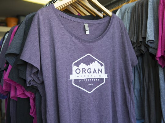 A rack full of Organ Mountain Outfitters t-shirts on Tuesday, October 11, 2016, at the companies headquarters.