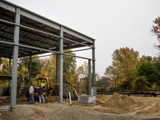 Contractors work on the construction of new engine bays Thursday, Oct. 20, 2016 at the Kimball Township Fire Station 1, 1970 Allen Road.