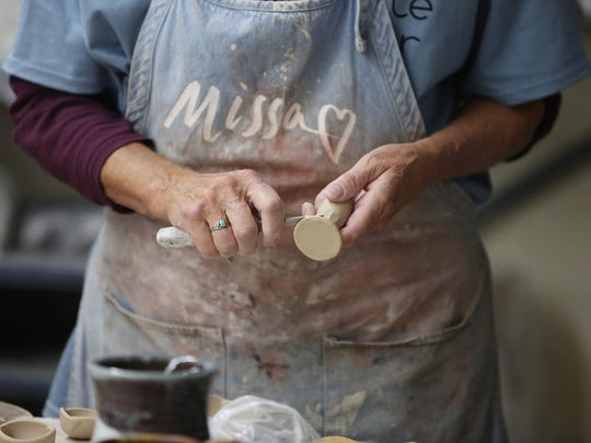 Tim and Michelle McMullen present a night of stress-relief utilizing clay at Silica Studios on Nov. 8, 2019.