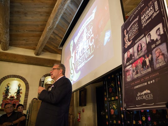 Phil san Filippo, Executive Director of the Las Cruces Convention and Visitors Bureau, unveils the 2017 line up for the Las Cruces Country Music Festival at La Posta de Mesilla to a room of sponsors and possible sponsors, Thursday, October 27, 2017.