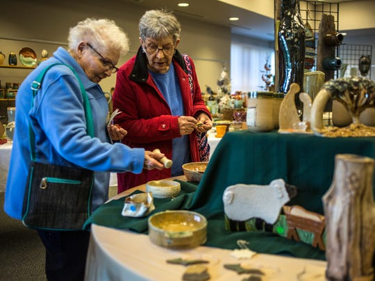 Lila Johnson and Alice Alexander of Armada look over items during the Potters Market Saturday, Nov. 12, 2016  at the SC4 Welcome Center.