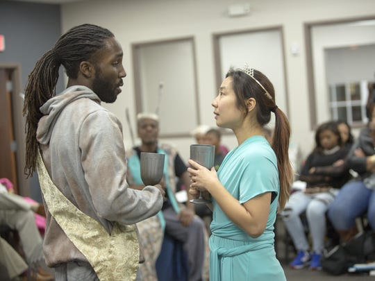 """Jamal Douglas (Pericles) and Bi Jean Ngo (Thaisa) perform at the Achievement Center of the Wilmington HOPE Commission in the Delaware Shakespeare Festival's touring production of """"Pericles."""""""