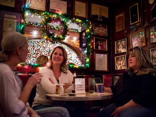 Tammy Lacy, of Port Huron, left, Jody Skonieczny, of China Township, and Jeanine Bauman McCanham, of Port Huron, enjoy Tom and Jerrys together Friday, Nov. 18, 2016 at The Brass Rail in downtown Port Huron.
