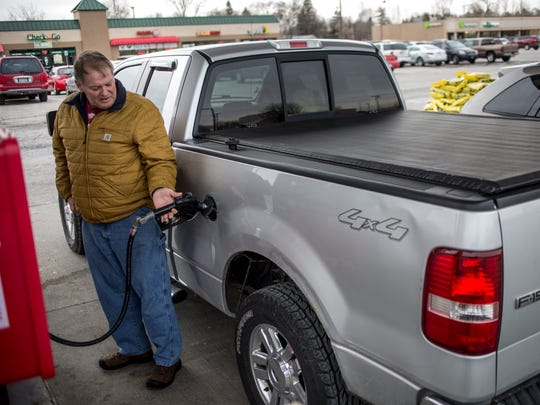 Pat Downing, of Port Huron, fuels up his truck Saturday, Dec. 31, 2016 at the Kroger Gas Station on 24th Street in Port Huron. Beginning in 2017, the gas tax will increase by 7.3 cents per gallon, for a total of 26.3 cents per gallon.