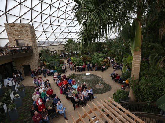 A crowd of people gather at the Greater Des Moines Botanical Garden during Botanical Blues on Sunday, Feb. 5, 2017, in Des Moines.