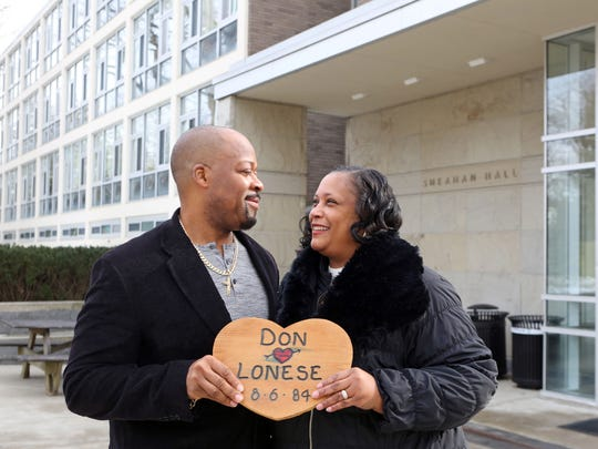 Don Johnson, 49, and his wife Lonese, 50, started dating in the summer of 1984 when they attended the Marist College Upward Bound program. Here they hold a memento from a trip to Great Adventure outside Sheahan Hall at Marist College, Feb. 3, 2017.