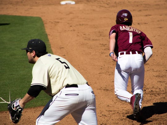 Tyler Daughtry (1) takes off towards second base on
