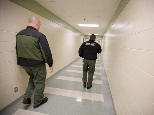 Marion County Sheriff's Office Lt. Joe Kast, left, and Institutions Division Commander Kevin T.D. Schultz walk to the infirmary on Thursday, March 2, 2017, at the Marion County Jail in Salem.