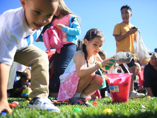 Melissa Conrads takes part in the Easter Egg Hunt during