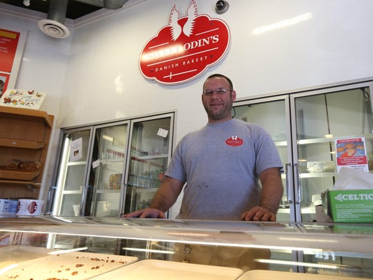Kevin Olesen, owner of Sweet Odin's, closed his family's bakery Saturday.