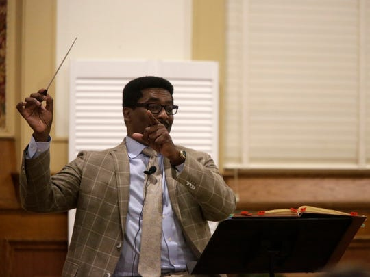 Andre Thomas conducts rehearsals of the Tallahassee