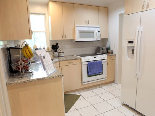The kitchen of a three-bedroom, two-bath Colonial in