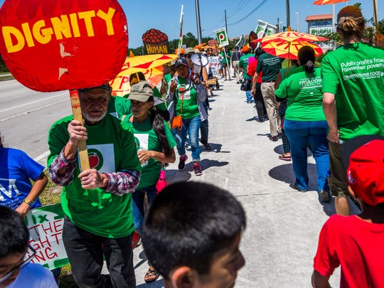 Protesters call for Publix to join the Coalition of Immokalee Workers' Fair Food Program outside the Orangetree Publix on Sunday, May 7, 2017.