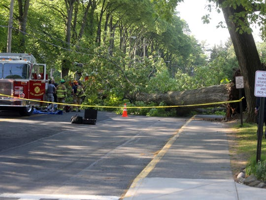 Emergency personnel work at the scene of a fatal accident in front of Upper Nyack School on North Broadway in Upper Nyack May 18, 2017. An 80-year-old man was killed when a tree fell on his car. Classes at the elementary school were canceled for the day.