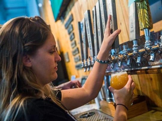 Chelsea Fischer fills a drink for a customer at Palm City Brewing in Fort Myers on Saturday, June 3, 2017. The grand opening will be June 17.