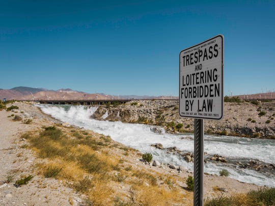 A photo of a no trespassing sign near the Whitewater River. In May, Desert Water Agency, the Coachella Valley Water District and multiple public safety agencies conducted a safety demonstration, dropping watermelons into the river to show how violent the currents can be.