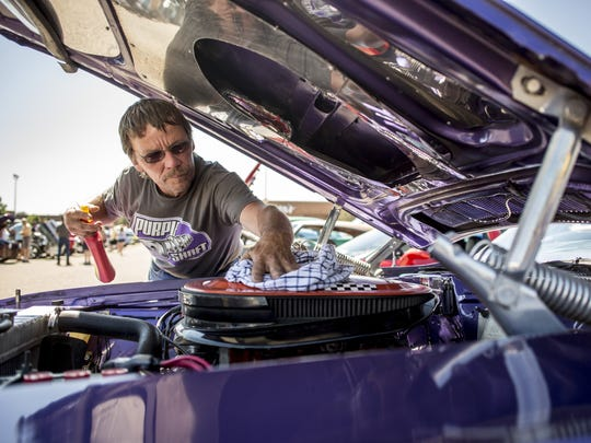 Roy Barnes of Linwood polishes his 1970 Plum Crazy Purple Dodge Challenger during the Keith Peterson Memorial Car Show at Birchwood Mall in Fort Gratiot.