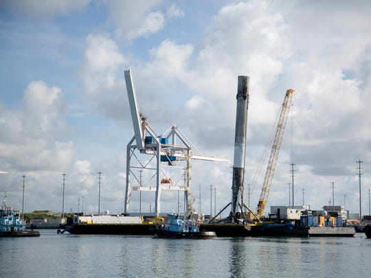 A SpaceX Falcon 9 first stage arrives at Port Canaveral on Thursday, after the successful BulgariaSat-1 launch from Kennedy Space Center.