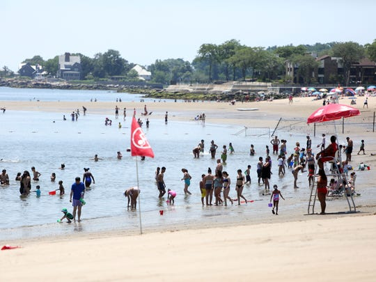 People cool off at Playland Beach in Rye.