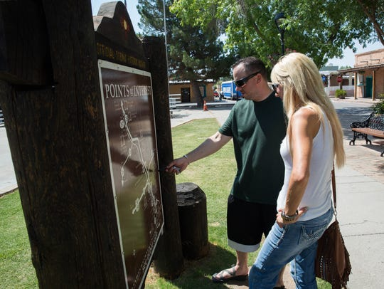 Cody Drake, left and Kim Maney, look over a map on