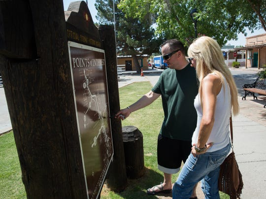 """Cody Drake, left and Kim Maney, look over a map on the Mesilla Plaza Wednesday, July 5, 2017. Drake and Maney stopped by Mesilla on their way back to Arizona after the holiday weekend. New Mexico Gov. Susana Martinez on Wednesday unveiled """"record-breaking"""" state tourism figures."""