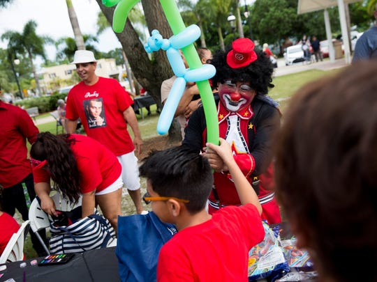 Floriberto Martinez-Martinez creates balloon animals for the kids as friends, family and residents show their support for the family of Jordan Valero,19, who was gunned down inside his home one year ago, at Riverside Park on Sunday, July 9, 2017, in Bonita Springs. Proceeds from the event will go toward a reward for any information leading to the arrest of a suspect.