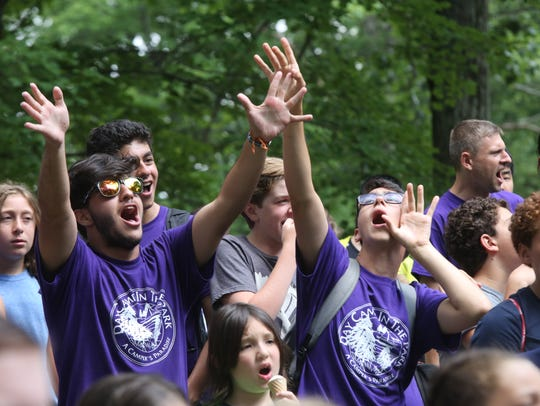 Campers cheer their fellow campers on during a bubble