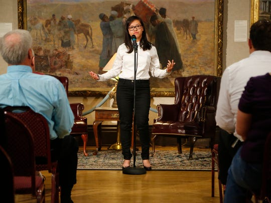 Linh Ta speaks at a Des Moines Storytellers event at