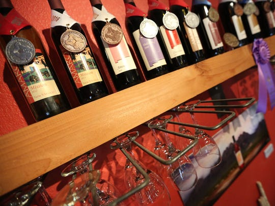 The walls are filled with wine bottles and awards at Amaro Winery.