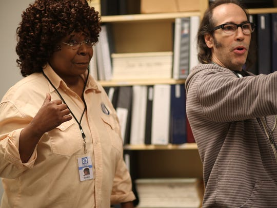 "Film director Martin Guigui works with Whoopi Goldberg on the set of his new movie ""9/11."""