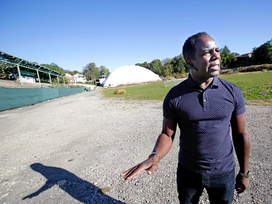 Mount Vernon Councilman Andre Wallace stands on an large landfill that wasn't officially approved by the city at Memorial Field in Mount Vernon on Oct. 20, 2017.