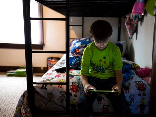 Miguel, 10, a resident of the House of Mercy, a home
