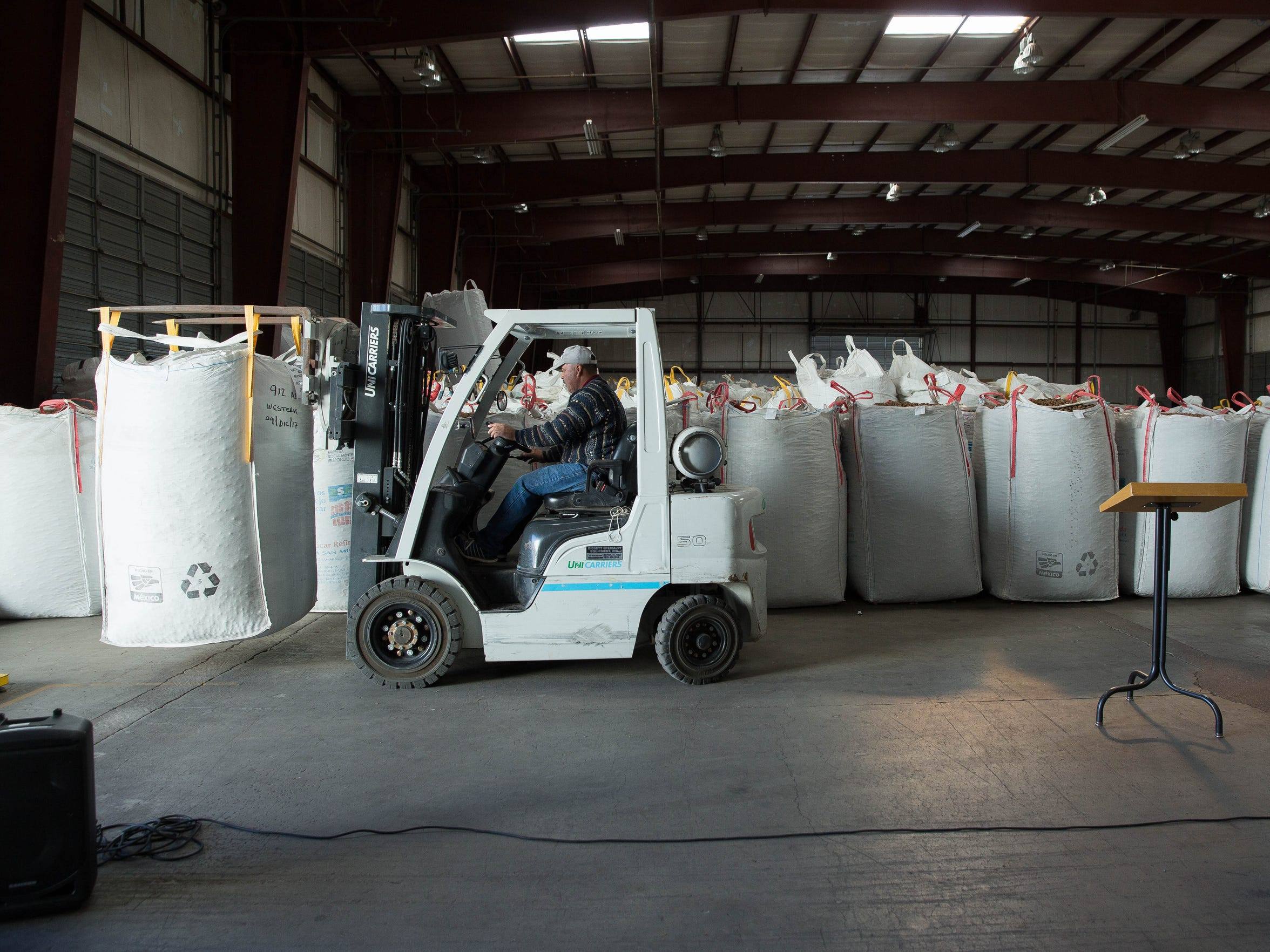 A worker at San Saba Pecan moves containers of pecans around the warehouse, before a press conference was held discussing the Pecan weevil quarantine and the theft of pecans in Doña Ana County. Wednesday Dec. 20, 2017.