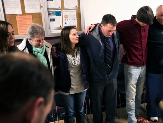 Kyle Keding joins friends and family in the Serenity Prayer, which is commonly used in recovery programs, inside the Wood County Courthouse before his sentencing in Wisconsin Rapids, Wis., Monday, February 5, 2018.