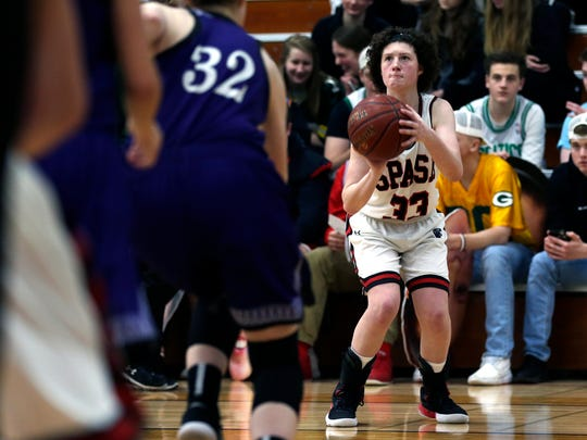 SPASH player Madisyn Rogan prepares to shoot a basket during the girl's basketball regional semifinal game between Stevens Point Area Senior High and Eau Claire Memorial in Stevens Point, Wis., February 23, 2018.