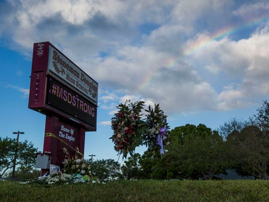 A rainbow appears over Marjory Stoneman Douglas High School on Monday, Feb. 26, 2018.