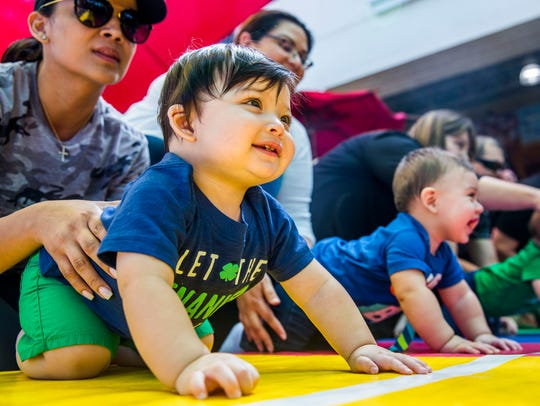 Adrian Lopez Jr., 11 months old, of Fort Myers, lines