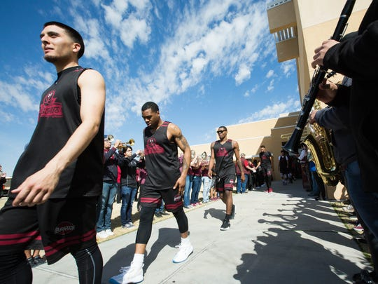 NMSU Mens Basketball Players Joe Garza, Aj Harris, Keyon Jones and Johnny McCants walk out of the Pan Am during a Send off rally, Wednesday March 14, 2018.