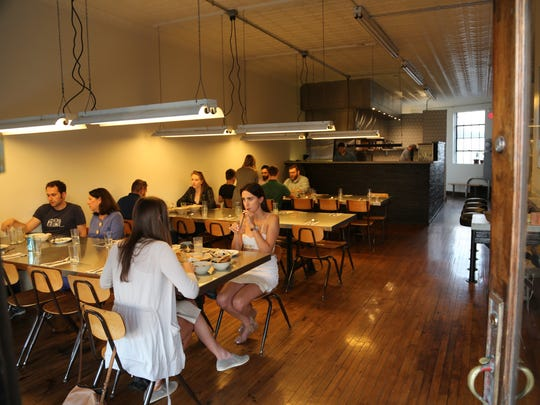 The spare dining room at Eastern Market's Gather restaurant