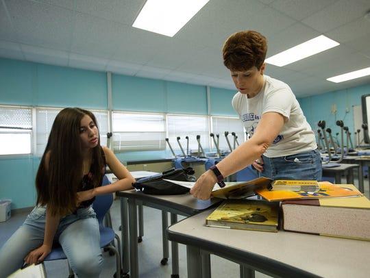 Kristina Martos, left, a seventh grade student at Lynn