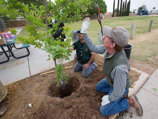 Jimmy Zabriskie,  right, the community forester for