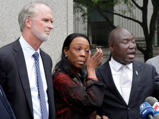 Jewel Upshaw, second left, mother of Zeke Upshaw, a G League basketball player who died in March after collapsing on the court during a game, is flanked by attorneys Bob Hilliard, left, and Benjamin Crump, outside Federal Court, in New York, Wednesday, May 30, 2018. She has filed a lawsuit accusing the NBA and the Detroit Pistons of negligence.