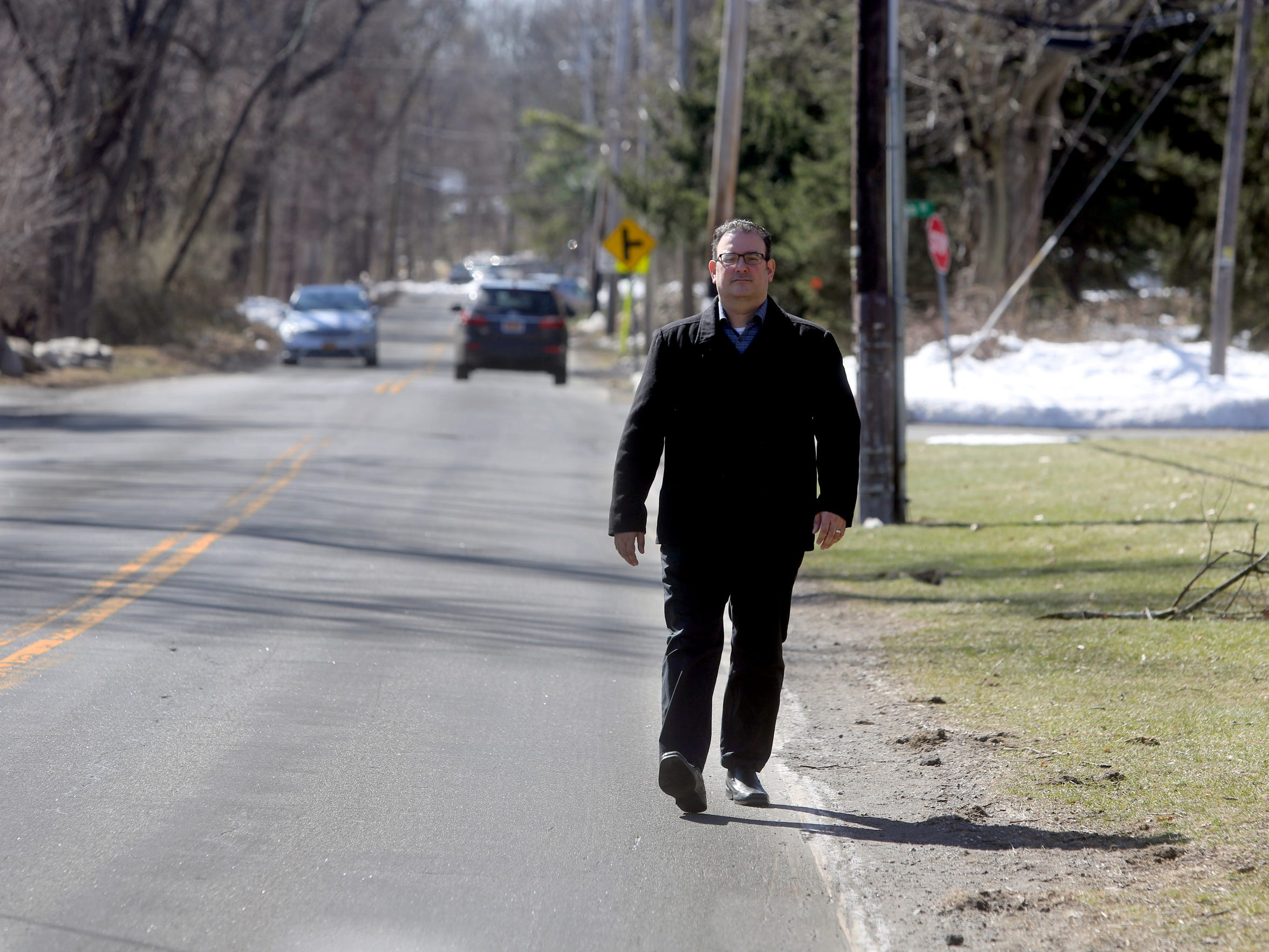 Airmont Mayor Philip Gigante walks along Cherry Lane near village hall on March 19, 2018. Gigante says code enforcement and the village building moratorium are applied equally to all residents, despite the claims of some Orthodox Jewish villagers, who say they are being held to a different standard when it comes to construction on their properties.
