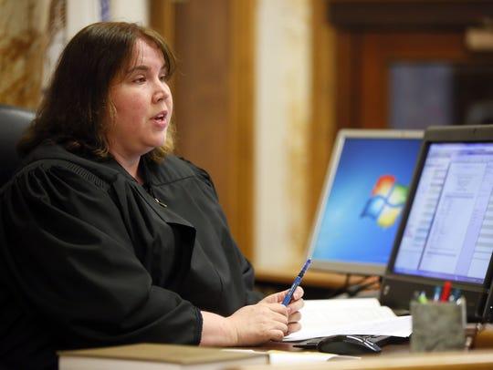 Polk County District Court Judge Heather Lauber sentences