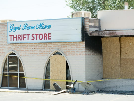 The windows are boarded up on Saturday, June 23, 2018, after a fire broke out at the Last Cruces Gospel Rescue Mission Thrift Store located at 1420 S. Solano Dr.